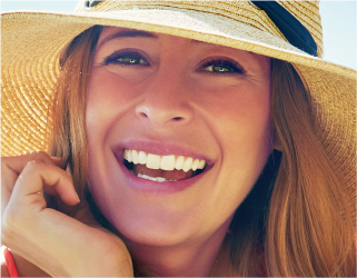 Woman smiling wearing a hat